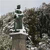 The statue of Queen Victoria after a rare fall of snow